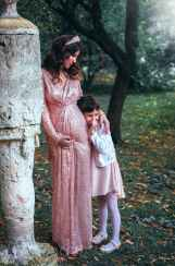 woman in pink long sleeved dress with child